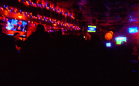 A dimly lit bar.